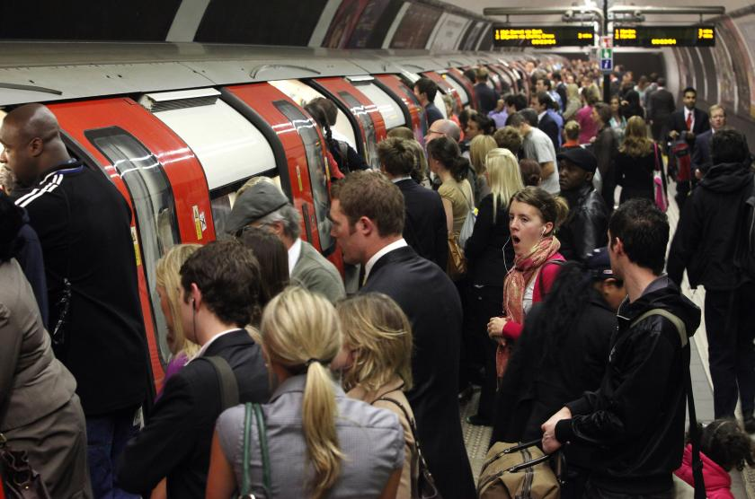 Londoners getting onto a tube
