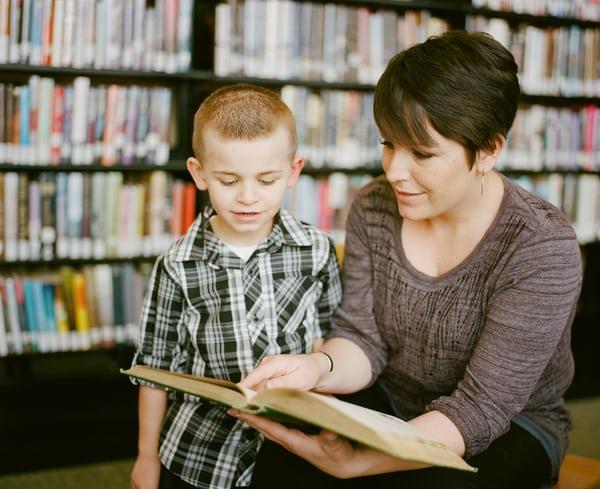 Adult Teaching a Kid
